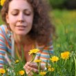Young woman holds dandelion which water from plastic bottle — Stock Video