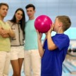 Students team watch on little boy throws bowling ball — Stock Video #32343575