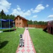 Playground near path through yard of country house — Stock Video