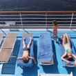 Mother, daughter and son sunbathe on board ship — Stock Video