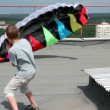 Stock Video: Boy stand and hold shroud lines, parachute inflated by air