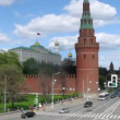 Vodovzvodnaya tower stands against Kremlin palace, time lapse — Stock Video