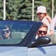 Stock Video: Young couple with kids ride backward in cabriolet at sunny day