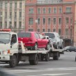 Stock Video: Police inspector stand near two breakdown trucks with cars