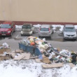 Stock Video: Dump of garbage lies in city near parking of cars