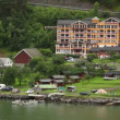 Grande Fjord Hotel in small coastal village among forest — Stock Video