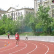 Athletes run on stadium racetrack of Olympic center — Stock Video