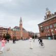 Stock video: People on city square (Radhusplatsen) photograph each other