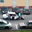 Several boys stand near old car with open hood and try to fix it — Stockvideo