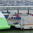 Automobiles ride to ferry boat in dock with huge parking — Stock Video