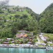 Grande Fjord Hotel in coastal village under mountain with road — Stock Video