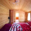 Stock Video: Bedroom in wooden house lit by light from windows
