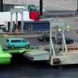 Stock Video: Cars ride from ferry boat in dock with truck parking
