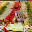 Stock Video: Lot of pieces of fruit cake, close up view in motion