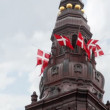 Christiansborg Slot with sculptures and fluttering flags — Stock Video
