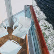 Furniture at balcony on vessel which floats in sea — Stock Video