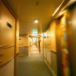 Stock Video: Motion through corridor with doors and lanterns on wall at ship