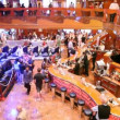 Stock Video: Spacious hall of Costa Luminosa with balcony, full of people