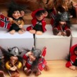 Stock Video: Many toy vikings with flags of Norway at showcase