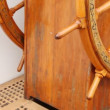 Old steering wheel from wood stands on sailing vessel deck. — Stock Video