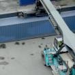 Stock Video: Crane lifts large weight container, view from above