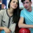 Young man with girl talk and laugh in bowling club — Vídeo de stock