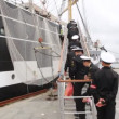Stock Video: Seamen rise on gangway of old sailing vessel Krusenstern
