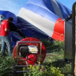 Worker of club of aeronautics pumps up air in balloon — Stock Video