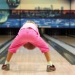 Little girl throws bowling ball, then jumps and walks away — Stock Video #32346643