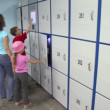 Stock Video: Family use automatic system in storage room