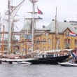 Known sailing boats of different countries stand in port — Stock Video