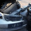 Two crashed cars stand on junkyard, closeup view in motion — Stock Video