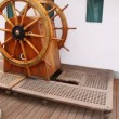 Old steering wheel from wood stands on sailing vessel deck — Stock Video