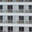 Stock Video: Worker on one of many balconies at multilevel cruise vessel