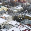 Stock Video: Roofs of houses are covered with white snow, time lapse