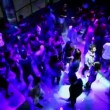 Stock Video: Many young boys and girls dance on discotheque in cruise ship