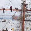 Sailors stand on ship mast during mooring on festival-regatta — Stock Video