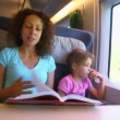 Mother reads book for children boy and girl when they travel — Stock Video