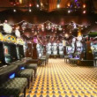 Motion through casino with lot of play machines around — Stock Video