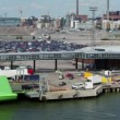 Stock Video: Cars ride from ferry boat in dock with huge parking