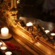 Burning candles and beads face a mirror in carved frame — Stock Video