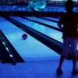 Little boy throws bowling ball and jumps — Stock Video