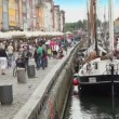 Tourists travel in Nyhavn in Copenhagen. — Stock Video
