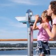 Girl looks in binocular on ship deck under direction of mother — Stock Video