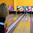 Stock Video: Girl throws bowling ball to beat pair of skittles, but missed