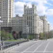 Cars go on Kotelnichesky Avenue near Stalin skyscraper — Stock Video