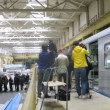 Stock Video: Journalist interviews chief near new train at plant