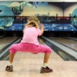 Little girl in pink clothes throws bowling ball and runs away — Stock Video #32348963