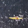 Man athlete quietly floats in yellow canoe in sunny day — Stock Video