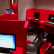 Several workplaces in empty internet cafe with red partitions — Stock Video